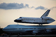 CAPE CANAVERAL, FL - JUNE 2:   Space Shuttle Atlantis, riding atop a modified 747 aircraft, taxis to the mate/demate structure at the shuttle landing facility at Kennedy Space Center in Cape Canaveral, Florida, June 2, 2009. Atlantis is returning to KSC after landing in California at the completion of its mission to repair the Hubble Space Telescope. (Photo by Matt Stroshane/Getty Images)