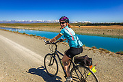 Cyclist riding the Tekapo Canal on the REI Adventures Cycle New Zealand trip