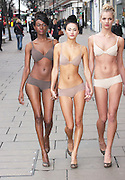 03.JANUARY.2011. LONDON<br /> <br /> DESIGNED TO MAKE THE WEARER FEEL LIKE THEY'RE NOT WEARING UNDERWEAR, M&S HAVE CREATED A COLOUR CODED SET AND HAD MODELS PARADE UP AND DOWN OXFORD STREET. A NICE SUPRISE FOR THE MORNING COMMUTERS! <br /> <br /> BYLINE: EDBIMAGEARCHIVE.COM<br /> <br /> *THIS IMAGE IS STRICTLY FOR UK NEWSPAPERS AND MAGAZINES ONLY*<br /> *FOR WORLD WIDE SALES AND WEB USE PLEASE CONTACT EDBIMAGEARCHIVE - 0208 954 5968*