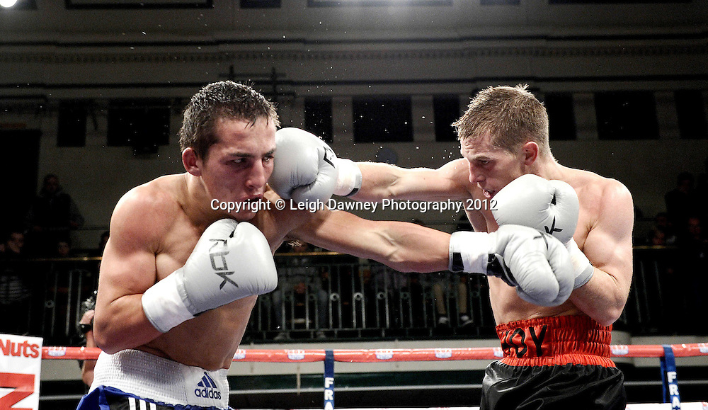 Charlie Hoy (red/black shorts) defeats Francis Croes in a Super Flyweight contest at York Hall, Bethnal Green, London on the 1st Novemeber 2012. Frank Warren Promotions. © Leigh Dawney Photography 2012.