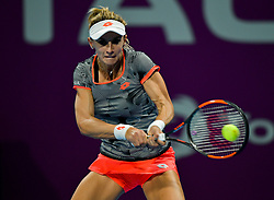 DOHA, Feb. 14, 2019  Lesia Tsurenko of Ukraine hits a return during the women's singles second round match between Simona Halep of Romania and Lesia Tsurenko of Ukraine at the 2019 WTA Qatar Open in Doha, Qatar, Feb. 13, 2019. Lesia Tsurenko lost 0-2. (Credit Image: © Nikku/Xinhua via ZUMA Wire)