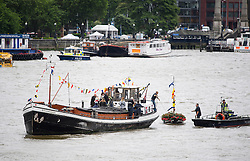 © Licensed to London News Pictures. 22/06/2016. London, UK.  A floral tribute boat for the late Jo Cox MP, being moored to a float on the River Thames ahead of a memorial service for the Labour MP who was killed in an attack outside her constituency office. Jo Cox would have turned 42 today.   Photo credit: Ben Cawthra/LNP