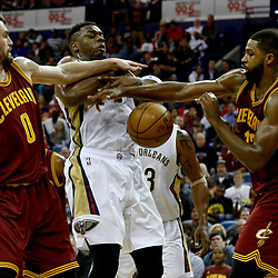 Jan 23, 2017; New Orleans, LA, USA; New Orleans Pelicans forward Terrence Jones (9) has the ball knocked away as Cleveland Cavaliers forward Kevin Love (0) and center Tristan Thompson (13) defend during the second half of a game at the Smoothie King Center. The Pelicans defeated the Cavaliers 124-122. Mandatory Credit: Derick E. Hingle-USA TODAY Sports