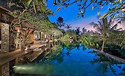Blue and pink sunset view over reflecting pool at a Bali villa