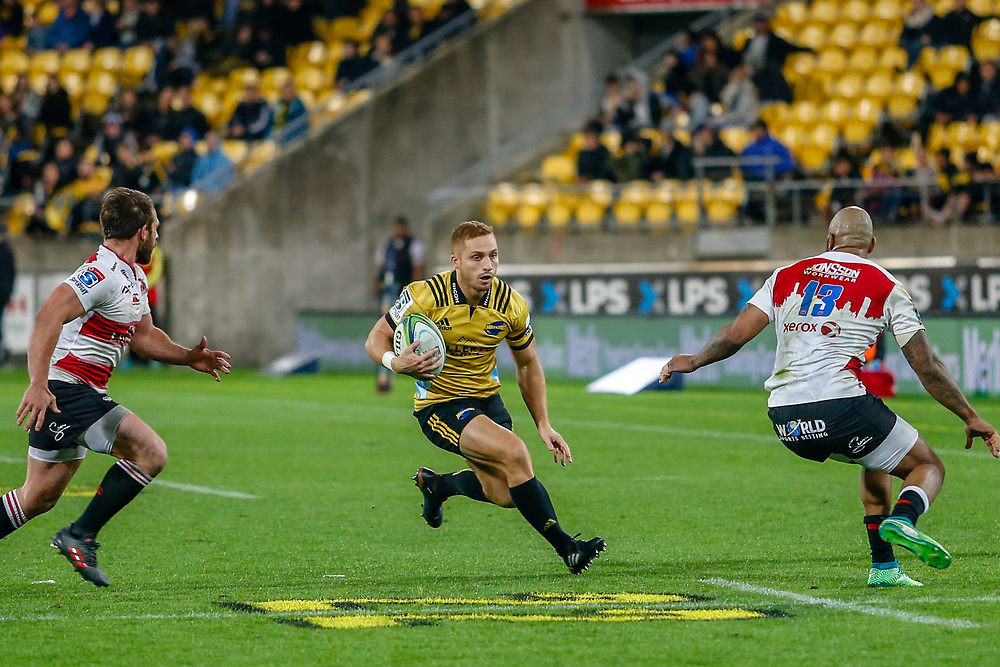 Ihaia West runs with the ball during the Super rugby (Round 12) match played between Hurricanes  v Lions, at Westpac Stadium, Wellington, New Zealand, on 5 May 2018.  Hurricanes won 28-19.