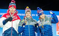 23.02.2019, Medal Plaza, Seefeld, AUT, FIS Weltmeisterschaften Ski Nordisch, Seefeld 2019, Skiathlon, Herren, 30km, Siegerehrung, im Bild Silbermedaillengewinner Alexander Bolshunov (RUS), Weltmeister und Goldmedaillengewinner, Sjur Roethe (NOR), Bronzemedaillengewinner Martin Johnsrud Sundby (NOR) // Silver medalist Alexander Bolshunov of Russian Federation World champion and Gold medalist Sjur Roethe of Norway and Bronce medalist Martin Johnsrud Sundby of Norway during the winner Ceremony for the men's 30km Skiathlon competition of FIS Nordic Ski World Championships 2019 at the Medal Plaza in Seefeld, Austria on 2019/02/23. EXPA Pictures © 2019, PhotoCredit: EXPA/ Stefan Adelsberger