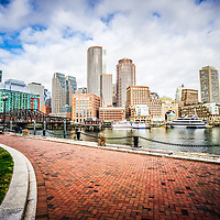 Boston Skyline harborwalk picture with Rowes Wharf, downtown Boston skyscrapers and Nothern Avenue Bridge.