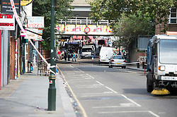 © London News Pictures. 30/08/2014. London, UK. A  cordoned off area of Portobello Road in West London today (30/08/2014) the scene of a fatal stabbing . A murder investigation has been launched after a Man aged in his fifties died of stab wounds in the early hours of this morning. Respect party politician George Galloway was alleged assaulted in the same area late yesterday evening. Photo credit : Ben Cawthra/LNP