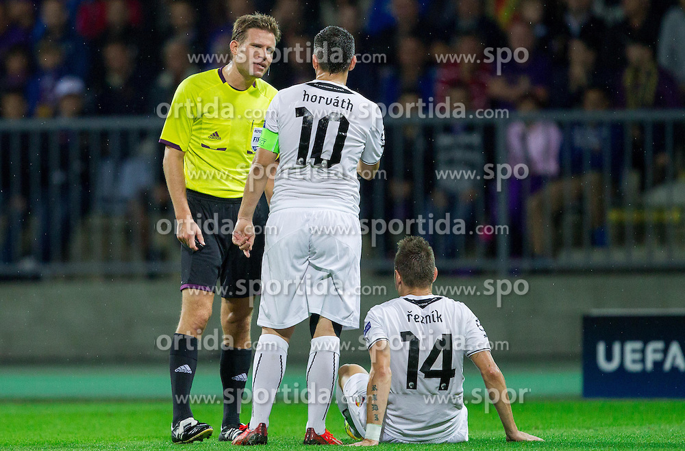 Referee Felix Brych (GER) talks to Pavel Horvath of Plzen and Radim Reznik of Plzen during Second Leg football match between NK Maribor (SLO) and FC Viktoria Plzen (CZE) of UEFA Champions League 2013/14 Play-Offs on August 28, 2013 in Stadium Ljudski vrt, Maribor, Slovenia. FC Viktoria Plzen defeated NK Maribor 1-0 and Qualify for Champions League 2013/14. (Photo by Vid Ponikvar / Sportida.com)