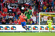 14.09.13. Brondby, Denmark.Gary Medel (L) of Chile and Mohanad Abdulraheem Karrar (R) of Irak jump for the ball during the international friendly match at the Brondby Stadium in Denmark.Photo: © Ricardo Ramirez