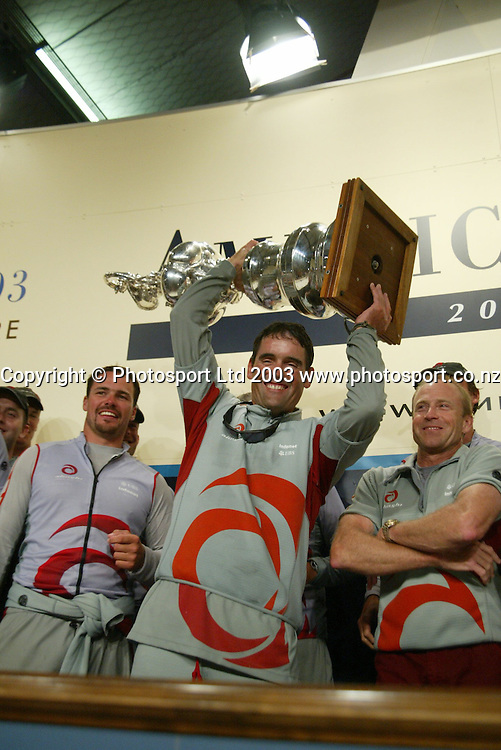 2 March 2003, Americas Cup Final, Post Press Conference, Viaduct Harbour, Auckland, New Zealand.<br />Russell Coutts with crew mates celebrating their victory.<br />Pic: Sandra Teddy/Photosport