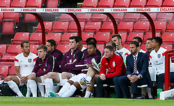 England U21 Manager, Gareth Southgate watches from the dug out alongside substitutes including Harry Kane - Photo mandatory by-line: Matt McNulty/JMP - Mobile: 07966 386802 - 11/06/2015 - SPORT - Football - Barnsley - Oakwell Stadium - England U21 v Belarus U21 - International Friendly U21s