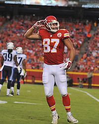Aug 28, 2015; Kansas City, MO, USA; Kansas City Chiefs tight end Travis Kelce (87) celebrates after a run during the first half against the Tennessee Titans at Arrowhead Stadium. The Chiefs won 34-10. Mandatory Credit: Denny Medley-USA TODAY Sports