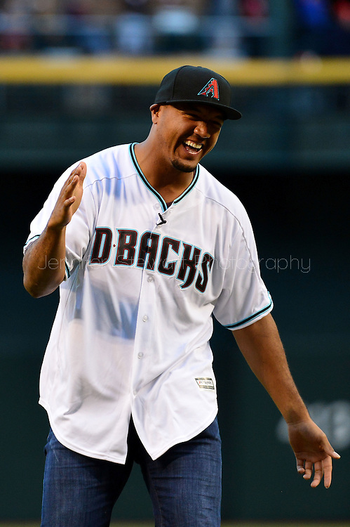 PHOENIX, AZ - APRIL 26:  Arizona Cardinals wide receiver Michael Floyd laughs after throwing out the ceremonial first pitch prior to the MLB game between the St. Louis Cardinals and Arizona Diamondbacks at Chase Field on April 26, 2016 in Phoenix, Arizona.  (Photo by Jennifer Stewart/Getty Images)