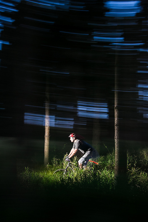 Riding through a dark forest in the evening.