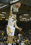 February 2 2011: Iowa Hawkeyes guard Matt Gatens (5) dunks the ball during the second half of an NCAA college basketball game at Carver-Hawkeye Arena in Iowa City, Iowa on February 2, 2011. Iowa defeated Michigan State 72-52.