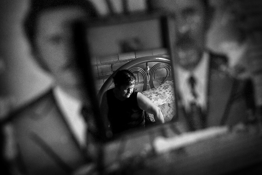 BRAZIL, SANTAREM. OCTOBER 2008. A woman reflexs in a mirror.<br /> She and her family had to leave their land because of the health problems caused by the agrochemicals used to soybean production next to their house.