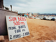 Sign on the beach advertising sunbeds and pedal boats Ibiza 2001