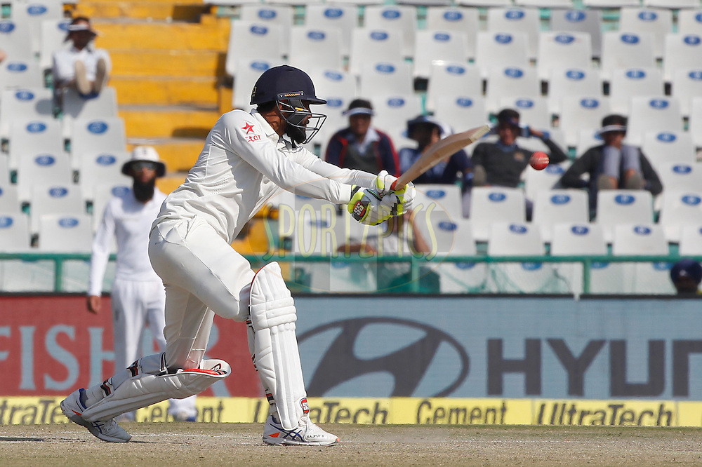 Ravindra Jadeja of India plays a shot during day 3 of the third test match between India and England held at the Punjab Cricket Association IS Bindra Stadium, Mohali on the 28th November 2016.<br /> <br /> Photo by: Deepak Malik/ BCCI/ SPORTZPICS
