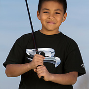 Portrait of a child participant in The First Tee of Monterey County, a non profit that exposes underprivileged kids to the game of golf.