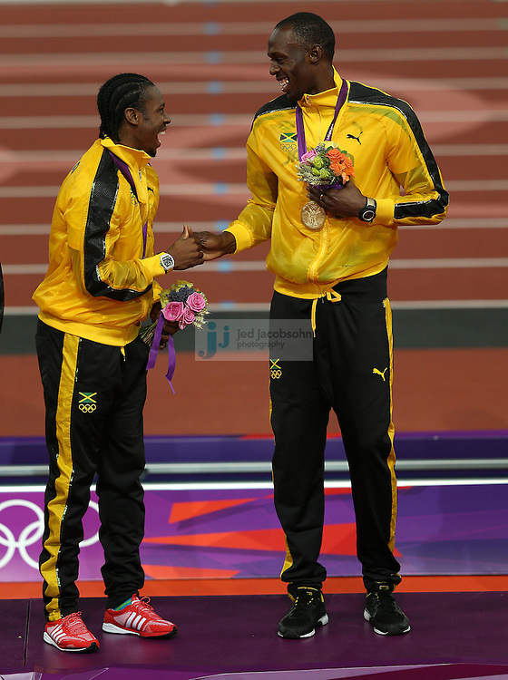 Usain Bolt (R) and Yohan Blake of Jamaica celebrate with their gold medals after winning the men's 4x100 relay race at the Olympic stadium during day 15 of the London Olympic Games in London, England, United Kingdom on August 11, 2012..(Jed Jacobsohn/for The New York Times)..
