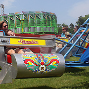 A grandmother and grandson enjoy a roller coaster ride during the Weston Fair, Weston, Connecticut, USA. 28th May 2012. Photo Tim Clayton