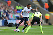 Bolton Wanderers midfielder Liam Feeney takes on Brighton winger, Jamie Murphy during the Sky Bet Championship match between Bolton Wanderers and Brighton and Hove Albion at the Macron Stadium, Bolton, England on 26 September 2015.