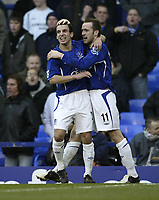 Photo: Aidan Ellis.<br /> Everton v Chelsea. The FA Cup. 28/01/2006.<br /> Everton's Leon Osman congratulate's goal scorer  James McFadden