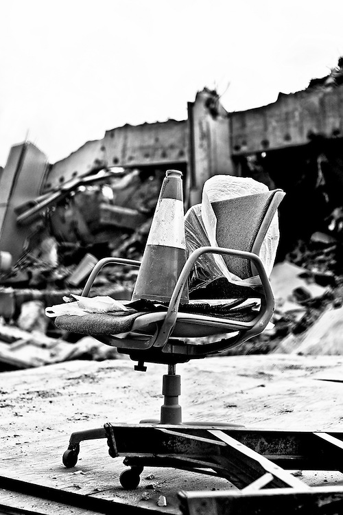 Office chair with traffic cone photographed during the demolition of the Charlotte Observer building.
