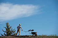 """A construction worker removes the """"living roof"""" at the Jackson Hole Visitor Center in Jackson, WY."""