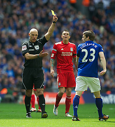 LONDON, ENGLAND - Saturday, April 14, 2012: Everton's Seamus Coleman is shown the yellow card by referee Howard Webb during the FA Cup Semi-Final match against Liverpool at Wembley. (Pic by David Rawcliffe/Propaganda)