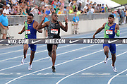 Jul 26, 2019; Des Moines, IA, USA; Christian Coleman (center) defeats Michael Rodgers (right) and Ronnie Baker (left) to win the 100m in 9.99 during the USATF Championships at Drake Stadium.