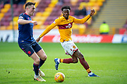 Gboly Ariyibi (#12) of Motherwell FC looks to close down John Souttar (#4) of Heart of Midlothian during the Ladbrokes Scottish Premiership match between Motherwell FC and Heart of Midlothian FC at Fir Park, Stadium, Motherwell, Scotland on 17 February 2019.
