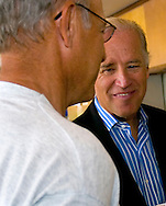 8/16/06 Des Moines. IA Sen. Joseph Biden speaks with Rich Haak, who was eating dinner near  an anti Wal Mart event in Des Moines Wednesday afternoon.  Haak spoke with Sen. Biden after the event. (Chris Machian/Prairie Pixel Group)