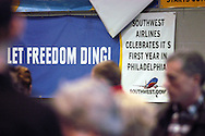 Southwest Airlines passengers pass a sign commorating one year at Philadelphia International Airport December 29, 2005 in Philadelphia, Pennsylvania. (Photo by William Thomas Cain)