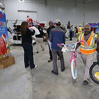 Theo Babb helps load toys that were donated by team members of Toyota to help with the Salvation Army Angel Tree.
