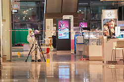 © licensed to London News Pictures. London, UK 29/06/2012. A forensic officer filming the crime scene at Westfields Shopping Centre in Stratford. A man suffering stab wounds, believed aged in his 20s, was pronounced dead on the ground floor of Westfields Shopping Centre in Stratford, after a fight involving a large group of males. Photo credit: Tolga Akmen/LNP