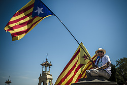 June 11, 2017 - Barcelona, Catalonia, Spain - A pro-independence demonstrator shows his flags during a manifestation at Barcelona's Montjuic Fountains in support of the recently announced referendum over Catalonia's independence from Spain in form of a republic at October 1st (Credit Image: © Matthias Oesterle via ZUMA Wire)
