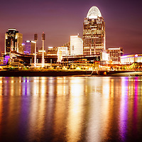 Cincinnati at night with downtown city office buildings including Great American Ballpark, Great American Insurance Group Tower, PNC Tower building, Omnicare building, US Bank building, Carew Tower building, Scripps Center building, and Fifth Third building. Photo was taken in July 2012 and is high resolution.