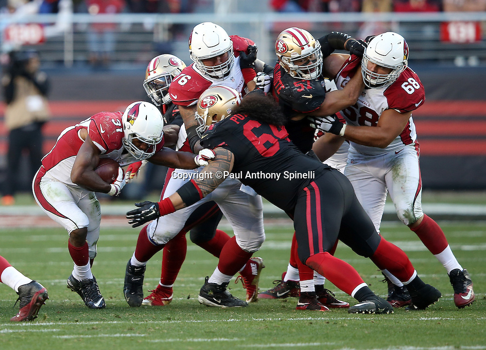 Arizona Cardinals running back and kick returner David Johnson (31) gets tackled by San Francisco 49ers nose tackle Mike Purcell (64) as he runs the ball during the 2015 week 12 regular season NFL football game against the San Francisco 49ers on Sunday, Nov. 29, 2015 in Santa Clara, Calif. The Cardinals won the game 19-13. (©Paul Anthony Spinelli)