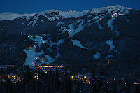 Blackcomb Mountain in the purple twilight of an early winter evening.