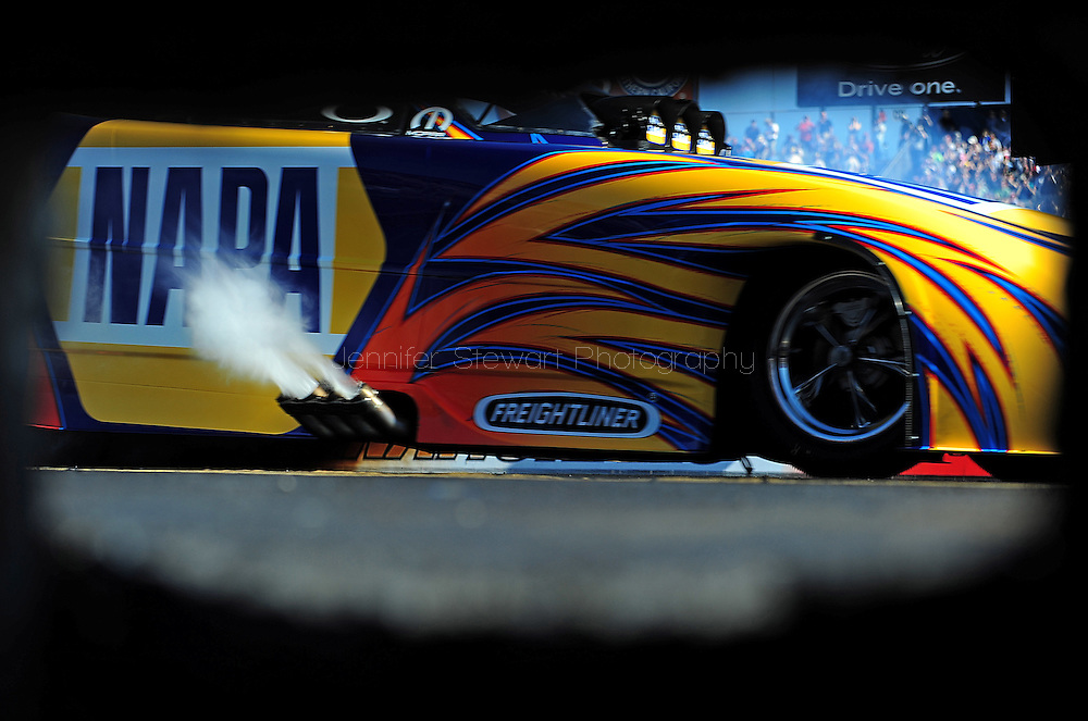 Feb. 13, 2010; Pomona, CA, USA; NHRA funny car driver Ron Capps does a burn out during qualifying at the Kragen O'Reilly Winternationals at Auto Club Raceway. Mandatory Credit: Jennifer Stewart-US PRESSWIRE