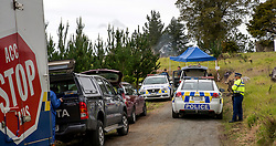 Smoke still rising as police and forensic investigators work at the scene of a multiple shooting and house fire which claimed 3 lives and left a man wounded at Mt Tiger, near Whangarei, New Zealand, Thursday, July 27, 2017. Credit:SMPA / Malcolm Pullman **NO ARCHIVING**