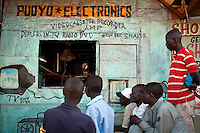 After polls closed in the Kibera slums, many residents gathered around electronic shops to watch as provisional results began appearing on local news stations.