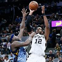 04 April 2017: San Antonio Spurs forward LaMarcus Aldridge (12) takes a jump shot over Memphis Grizzlies forward Zach Randolph (50) during the San Antonio Spurs 95-89 OT victory over the Memphis Grizzlies, at the AT&T Center, San Antonio, Texas, USA.