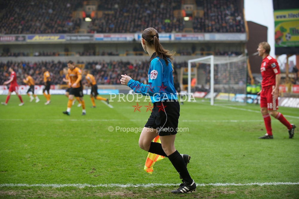 WOLVERHAMPTON, ENGLAND - Saturday, January 22, 2011: Assistant referee Sian Massey runs the line as Liverpool take on Wolverhampton Wanderers during the Premiership match at Molineux. (Photo by David Rawcliffe/Propaganda)