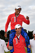 Stewart Hagestad (USA) holds Akshay Bhatia (USA) on his shoulders after the Team USA's  victory 15.5 to 10.5 to retain the Walker Cup after the Sunday Singles in the Walker Cup at the Royal Liverpool Golf Club, Sunday, Sept 8, 2019, in Hoylake, United Kingdom. (Steve Flynn/Image of Sport)