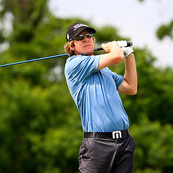 2009 April 26: Aron Price of Sydney, Australia lines tee's off from the eighth hole during the final round of the Zurich Classic of New Orleans PGA Tour golf tournament played at TPC Louisiana in Avondale, Louisiana.