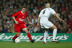 CARDIFF, WALES - Sunday, March 2, 2003: Liverpool's Michael Owen takes on Manchester United's Rio Ferdinand during the Football League Cup Final at the Millennium Stadium. (Pic by David Rawcliffe/Propaganda)