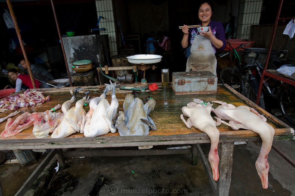 A vendor sells duck meat at a market stall in Sichuan Province, China.